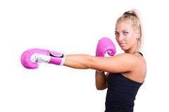 Woman wearing pink boxing gloves Stock Photo