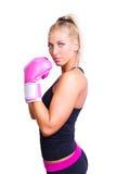 Woman wearing pink boxing gloves Royalty Free Stock Photos