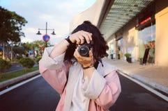Woman Wearing Pink Coat Holding Dslr Camera Stock Photo
