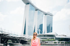 Woman Wearing Pink Dress in a Distance of a Building Stock Photos