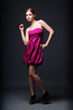 Woman wearing pink dress and high heels Royalty Free Stock Images