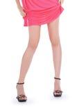 Woman wearing a pink dress posing Royalty Free Stock Image