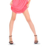 Woman wearing a pink dress posing over white Royalty Free Stock Photography