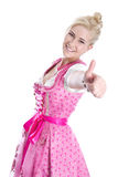 Woman wearing pink dress showing thumb up Stock Photography