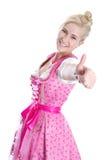 Woman wearing pink dress showing thumb up Royalty Free Stock Photo