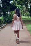 Woman Wearing Pink Mini Dress Walking on Walkway Royalty Free Stock Photo