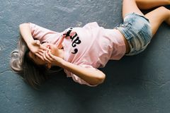 Woman Wearing Pink Printed Crew-neck T-shirt and Blue Faded Denim Shorts Royalty Free Stock Photography