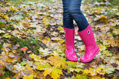 Woman wearing pink rubber boots in fall Stock Images