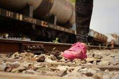 Woman wearing pink shoes at train station. Royalty Free Stock Photography