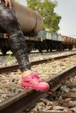 Woman wearing pink shoes at train station. Royalty Free Stock Images