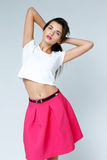 Woman wearing pink skirt Stock Photography