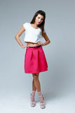 Woman wearing pink skirt Royalty Free Stock Photography