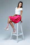 Woman wearing pink skirt Royalty Free Stock Images