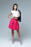 Woman wearing pink skirt Royalty Free Stock Photos