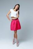 Woman wearing pink skirt Royalty Free Stock Image