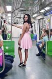 Woman Wearing Pink Sleeveless Dress Inside the Train Royalty Free Stock Photos