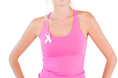 Woman wearing pink tank top and breast cancer ribbon Stock Images
