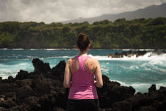 Woman Wearing Pink Tank Top Facing Sea Stock Photo