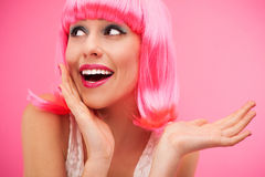 Woman wearing pink wig Stock Images