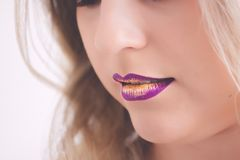 Woman Wearing Pink and Yellow Lipstick Royalty Free Stock Images