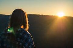 Woman Wearing Plaid Shirt Facing Sun during Golden Hour Stock Photos