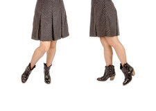 Woman Wearing Polka Dot Mini Skirt and Black Leather Cowboy Boots Royalty Free Stock Photography
