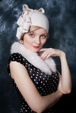 Woman wearing polka-dotted dress and felt adornment Royalty Free Stock Images