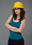 Woman wearing a protection helmet, studio portrait Royalty Free Stock Photography