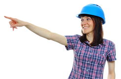 Woman wearing protective blue helmet and pointing into distance Royalty Free Stock Photography