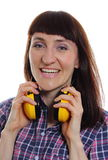 Woman wearing protective headphones Royalty Free Stock Image