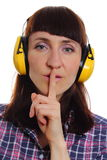 Woman wearing protective headphones, silence sign Stock Photo