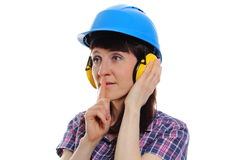 Woman wearing protective helmet and headphones Royalty Free Stock Image