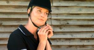 Woman wearing protective helmet 4k. Woman wearing protective helmet in ranch 4k stock video