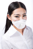 Woman wearing a protective mask with Stock Image