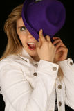Woman wearing a purple hat hiding half of her face Royalty Free Stock Photo