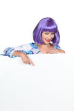 Woman wearing purple wig Royalty Free Stock Images