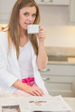Woman wearing  pyjamas and drinking a beverage Stock Photography