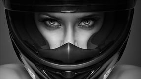 Woman wearing racing helmet Stock Images