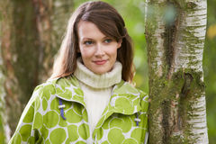 Woman Wearing Raincoat Walking In Woods Stock Photos