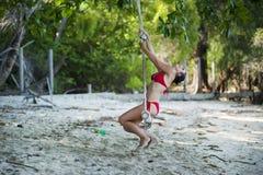 Woman Wearing Red Bikini Swinging Stock Photography