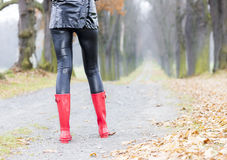 Woman wearing red boots Royalty Free Stock Photography
