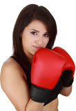 Woman wearing red boxing glove Stock Photos