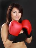 Woman wearing red boxing glove. Beautiful hispanic woman wearing red boxing glove Royalty Free Stock Photos