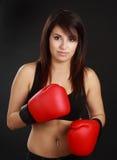 Woman wearing red boxing glove. Beautiful hispanic woman wearing red boxing glove Royalty Free Stock Photography