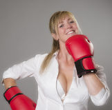 Woman wearing red boxing gloves Royalty Free Stock Image