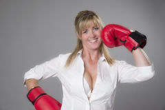 Woman wearing red boxing gloves Royalty Free Stock Photo