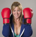 Woman wearing red boxing gloves Stock Photo