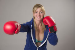 Woman wearing red boxing gloves Stock Images