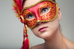 Woman wearing red carnival mask Royalty Free Stock Photo