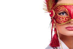 Woman wearing red carnival mask Stock Images